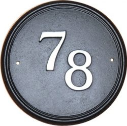 Circular cast iron house number sign.