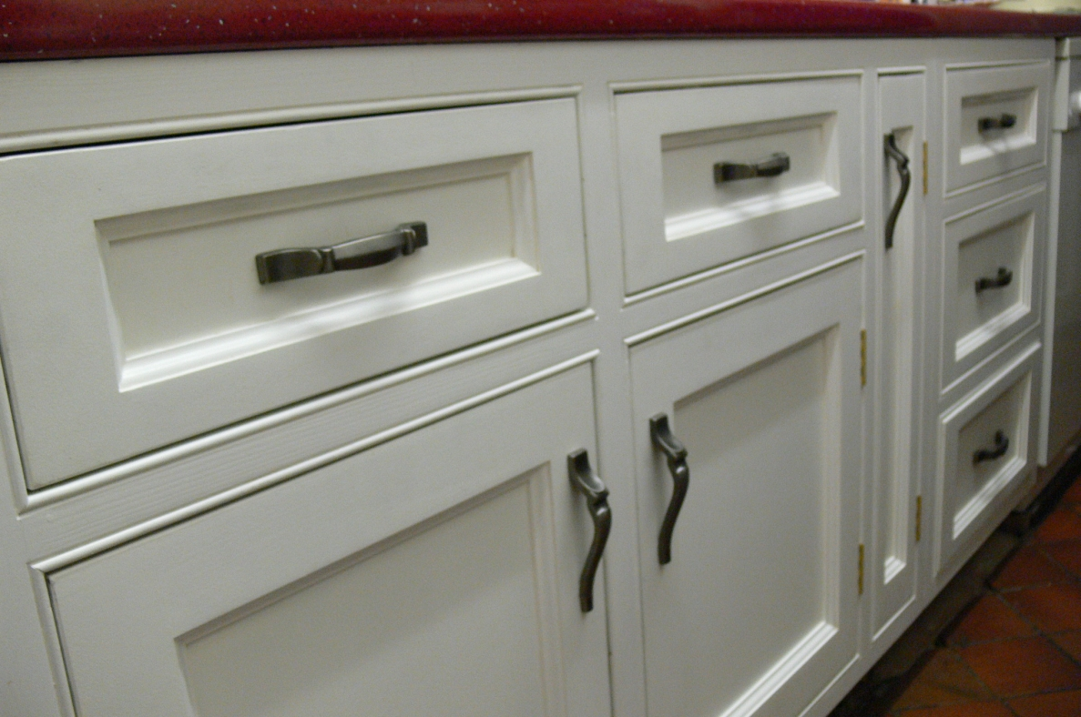 Adding handles to kitchen cabinets cast iron cabinet draw for Adding knobs to kitchen cabinets