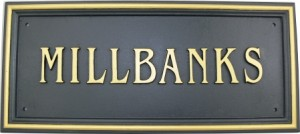 cast iron house business name sign
