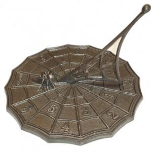Cast iron spider sundial.