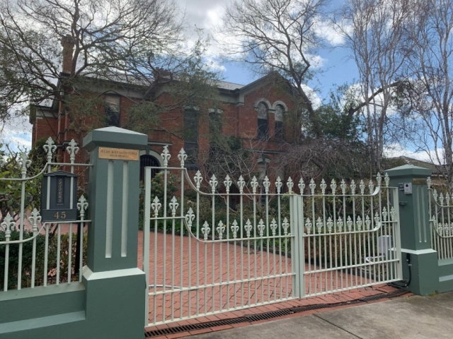 Cast iron railing mounted letterbox